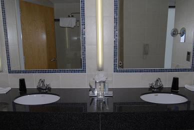 A picture of the two sinks in  the bathroom.  Emma thought this was really cool. I think she wants this.